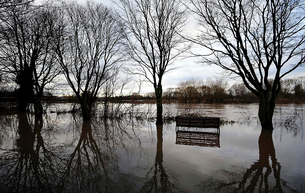 . Flood waters cover the parklands at Washlands Park in Burton On Trent, England, Tuesday Dec. 25, 2012, during a lull in the rainy weather on Christmas Day.  Hopes of a white Christmas were washed out as many Britans awoke to Yuletide flooding across many regions of the country.  (AP Photo / Rui Vieira, PA)