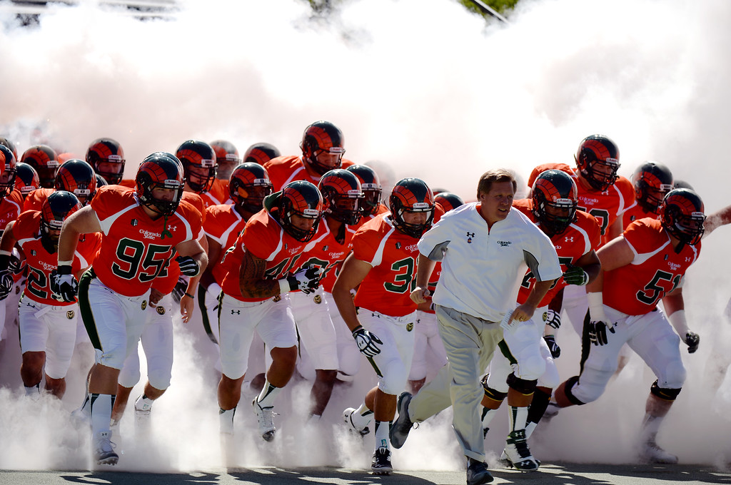 . FORT COLLINS, CO - September 28 : Head coach Jim McElwain of Colorado State University leads his players into Hughes Stadium for the game against University of Texas at El Paso. Fort Collins, Colorado. September 28, 2013. (Photo by Hyoung Chang/The Denver Post)
