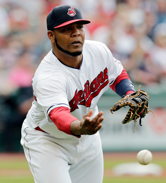 . Cleveland Indians\' Edwin Encarnacion tosses the ball to Cleveland Indians\' Jason Kipnis to get Oakland Athletics\' Matt Joyce out at first base in the second inning of a baseball game, Tuesday, May 30, 2017, in Cleveland. (AP Photo/Tony Dejak)