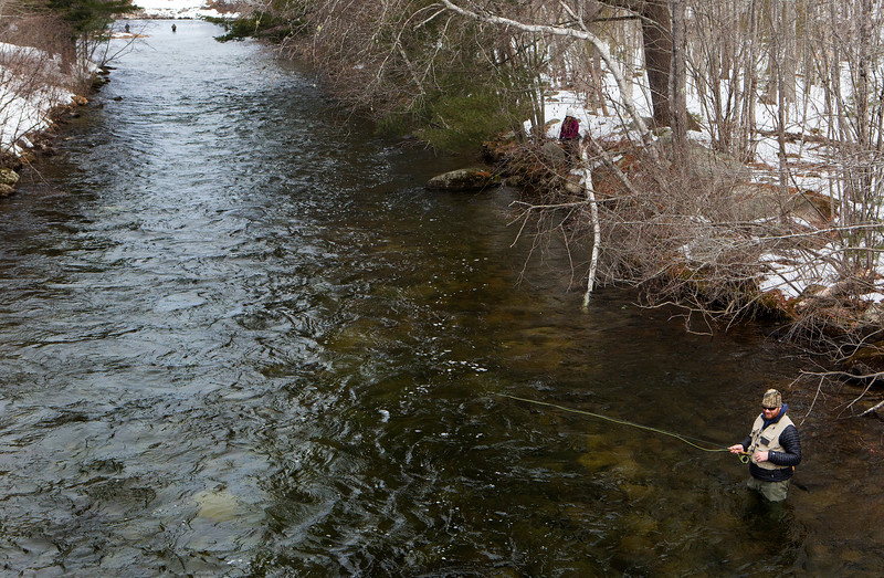 GRAND LAKE STREAM, Maine -- 04/01/2017 -- Chris Gorham throws his line during opening day of open water fishing season at Grand Lake Stream in Grand Lake Stream Saturday. Ashley L. Conti | BDN