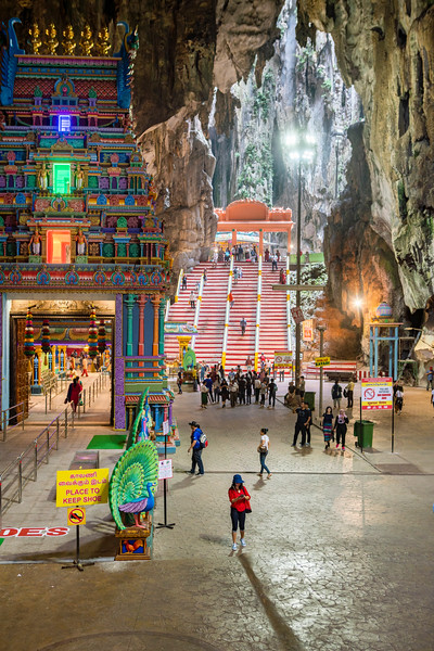 Tourists and Hindu devotees explore the massive cave complex of the Batu Cave Temple in Kuala Lumpur, Malaysia. The temple was built in the caves in the late 1890s and continues to be an important place of worship in Kuala Lumpur.