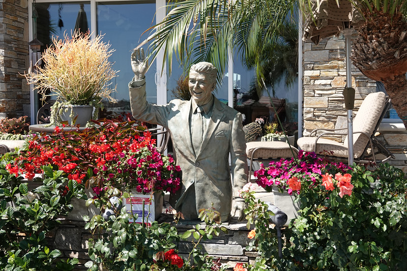 In Orange County, traditionally a Republican stronghold, people pose with a statue of former president Ronald Reagan in front of a resident's home.