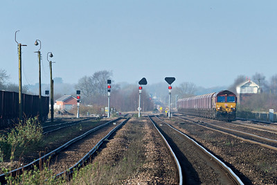 DB Class 66111 passes Wrawby Signal Box with empty coal forImmingham