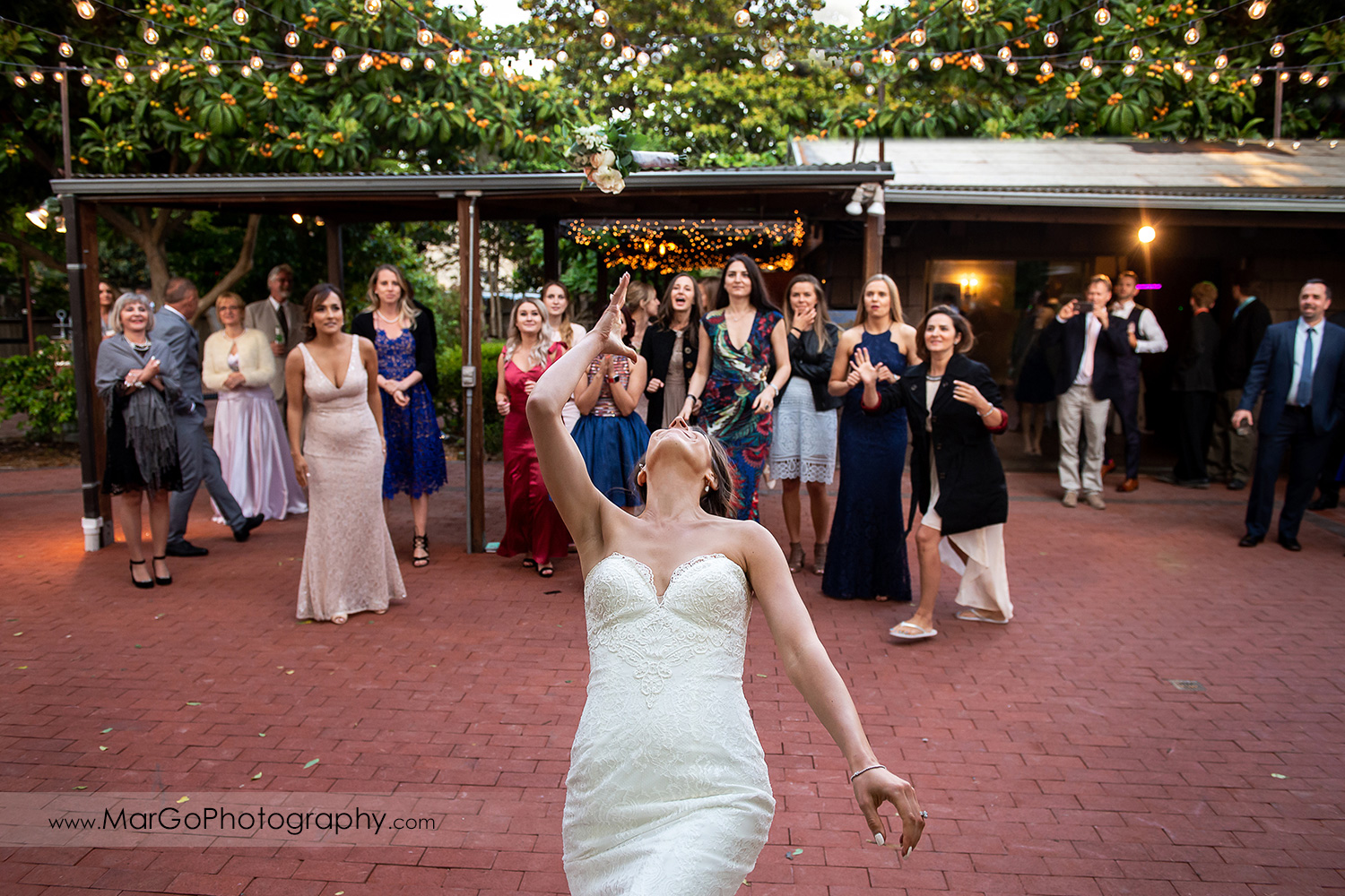 bride tossing bouquet during wedding reception at San Pablo Rockefeller Lodge