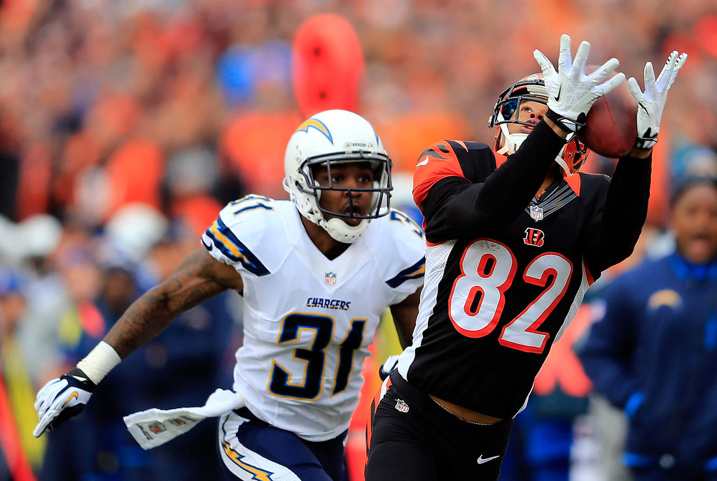 . Wide receiver Marvin Jones #82 of the Cincinnati Bengals makes a catch as cornerback Richard Marshall #31 of the San Diego Chargers defends during a Wild Card Playoff game at Paul Brown Stadium on January 5, 2014 in Cincinnati, Ohio.  (Photo by Rob Carr/Getty Images)