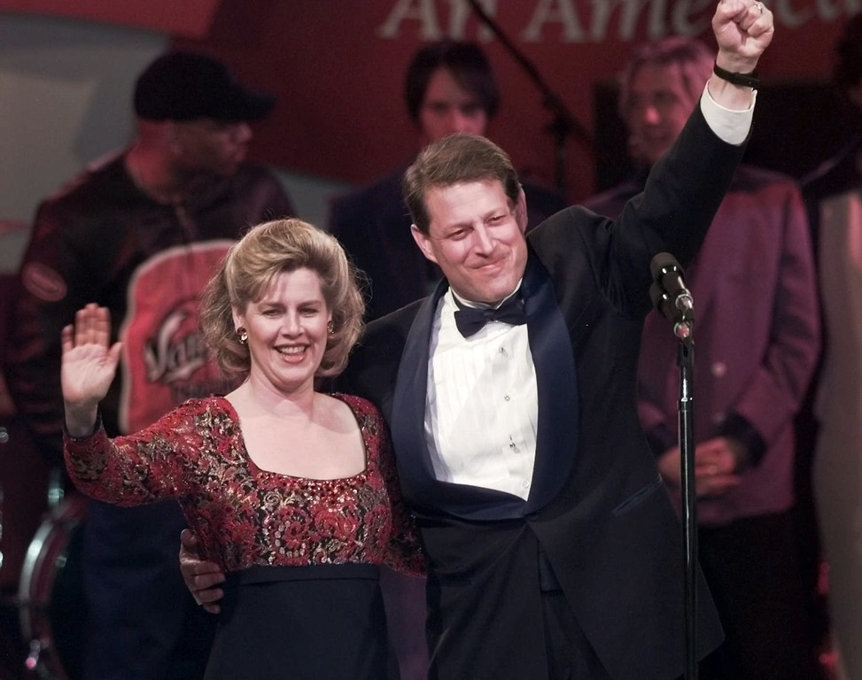. Vice President Al Gore and his wife Tipper gesture to guests of teh 21st Century Ball at the Postal Museum Monday, Jan. 20, 1997, in Washington.  (AP Photo/Brian Diggs)