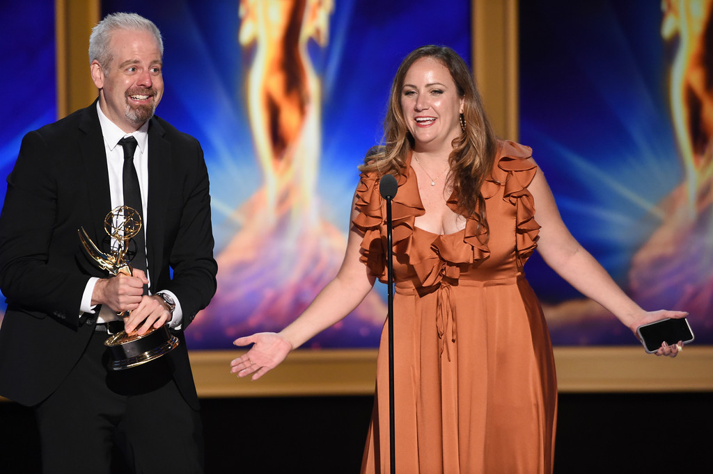 ". Aaron Bleyaert, left, and Ruthie Wyatt accept the award for outstanding creative achievement in interactive media within an unscripted program for ""Conan Without Borders\"" during night two of the Television Academy\'s 2018 Creative Arts Emmy Awards at the Microsoft Theater on Sunday, Sept. 9, 2018, in Los Angeles. (Photo by Phil McCarten/Invision/AP)"