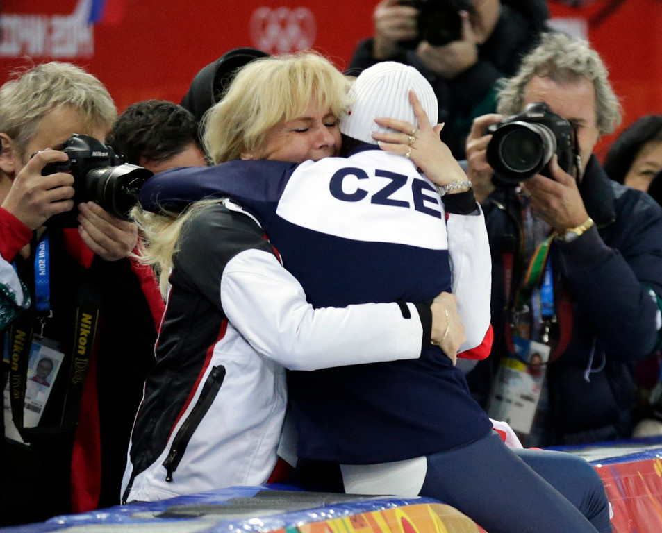 . Martina Sablikova of the Czech Republic hugs her mother as she celebrates winning gold in the women\'s 5,000-meter speedskating race at the Adler Arena Skating Center during the 2014 Winter Olympics in Sochi, Russia, Wednesday, Feb. 19, 2014. (AP Photo/Matt Dunham)