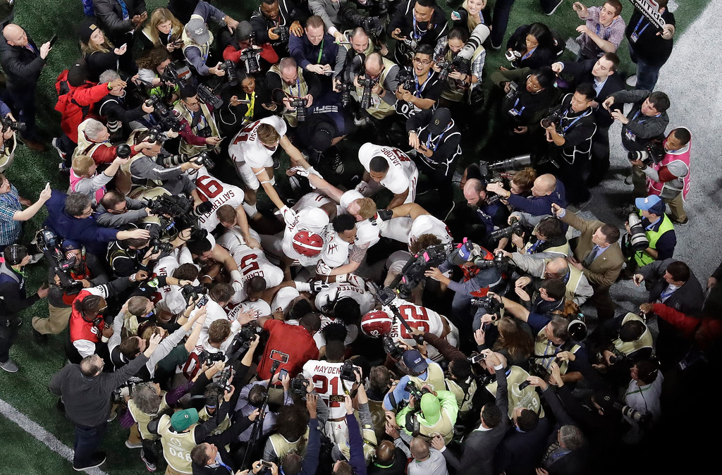 . Alabama players celebrate after overtime of the NCAA college football playoff championship game against Georgia Monday, Jan. 8, 2018, in Atlanta. Alabama won 26-23. (AP Photo/John Bazemore)
