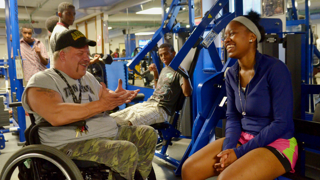. After a rigorous workout, Rika Shabazz laughs with teen center director Rob Wills, left, at Mary\'s Place, a transitional shelter in Minneapolis. (Pioneer Press: John Autey)