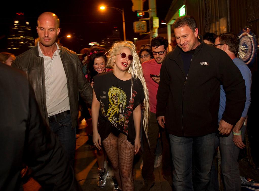 . Lady Gaga walks down a street during SXSW 2014 Music Festival early Wednesday, March 12, 2014, in Austin, Texas. (AP Photo/Austin American-Statesman, Jay Janner)