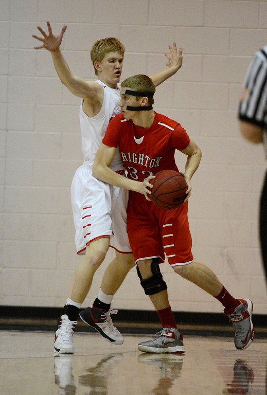. Chaparral\'s Jake Holtzmann (10) plays tough defense on Michael Goward (32) during the first quarter February 27, 2013. (Photo By John Leyba/The Denver Post)