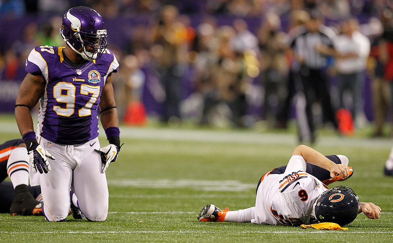 . Chicago Bears quarterback Jay Cutler (6) lays on the field after getting tackled by Minnesota Vikings defensive end Everson Griffen, left, during the second half of an NFL football game Sunday, Dec. 9, 2012, in Minneapolis. Griffen was called for a personal foul on the play. (AP Photo/Genevieve Ross)