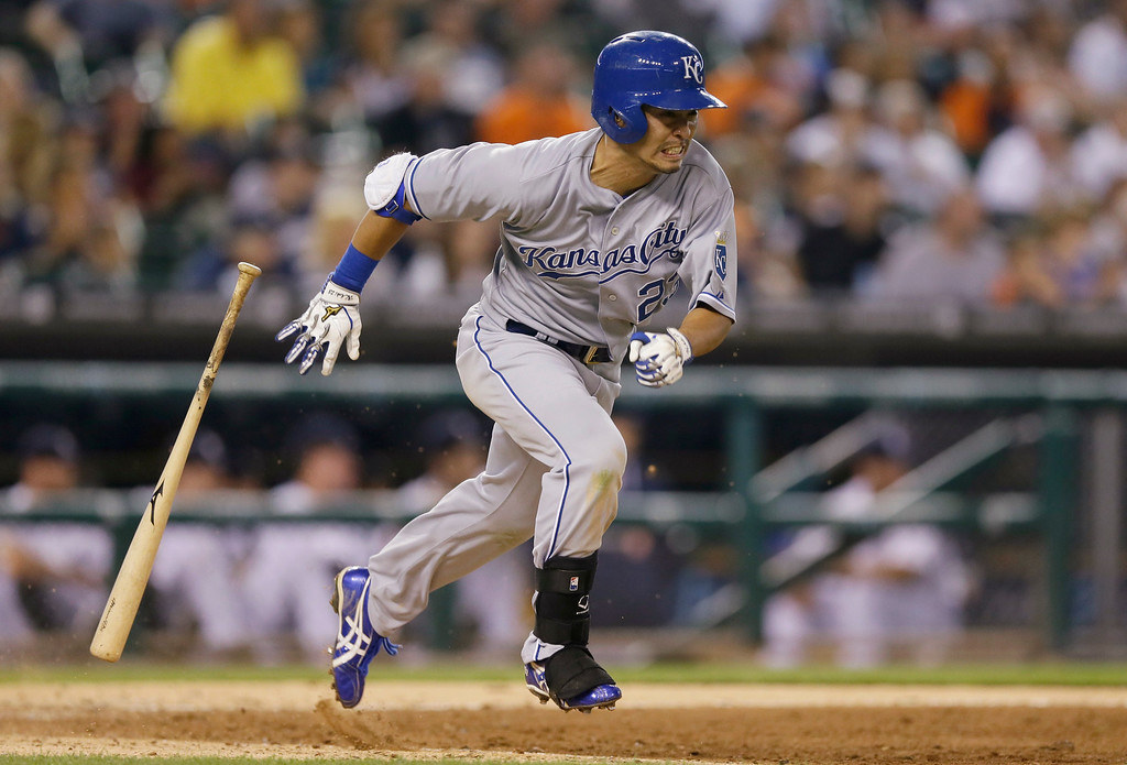 . Kansas City Royals\' Norichika Aoki runs to first and beats the throw from Detroit Tigers shortstop Andrew Romine during the ninth inning of a baseball game in Detroit, Tuesday, Sept. 9, 2014. (AP Photo/Carlos Osorio)