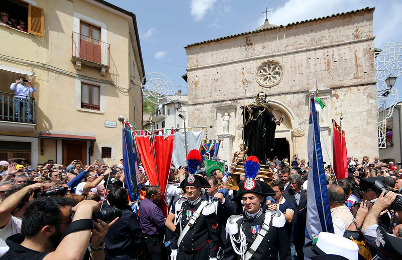 . Carabinieri (front, C) lead the procession for a wooden statue of St. Domenico (rear, C), covered with snakes, in Cocullo, central Italy May 1, 2013. Every year in May, snakes are placed onto the statue of St. Domenico, which is then carried in a procession around the town. St. Domenico is believed to be the patron saint for people who have been bitten by snakes. REUTERS/Alessandro Bianchi