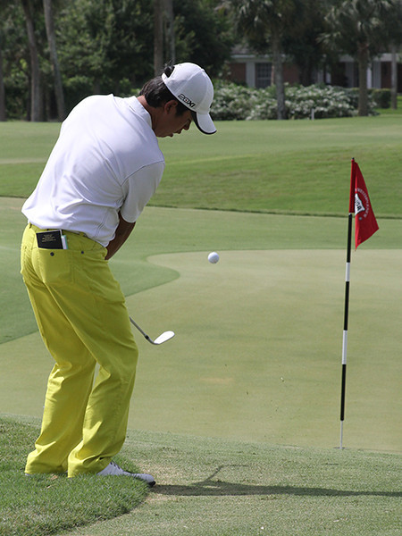 Tae Wan Lee, of Orlando, Fla., follows through on a chip shot in first-round action at Country Club of Florida.