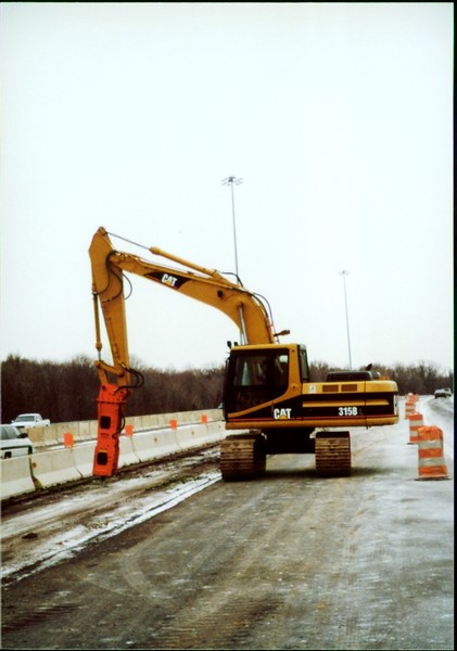 NPK E208 hydraulic hammer on Cat excavator - road construction at 83 & I-71 in Strongsville 12-15-00 (6).JPG