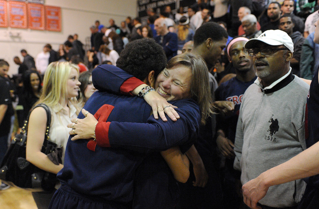 . La Verne Lutheran\'s Aaron Provence is hugged by fans after his team beat Bishop Montgomery in a CIF SS Division IV-AA semifinal game in Torrance Friday night. Lutheran stunned Bishop Montgomery 63-59, ending their unbeaten season. 20130222 Photo by Steve McCrank / Staff Photographer