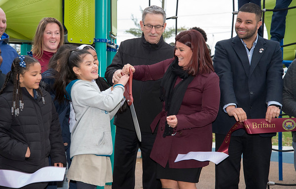 11/04/19 Wesley Bunnell | StaffrrA ribbon cutting was held at Chesley Park celebrating the completion of the Phase 2 renovation project. MIlexis Nieves, age 9, helps Mayor Erin Stewart cut the ribbon on the playground.