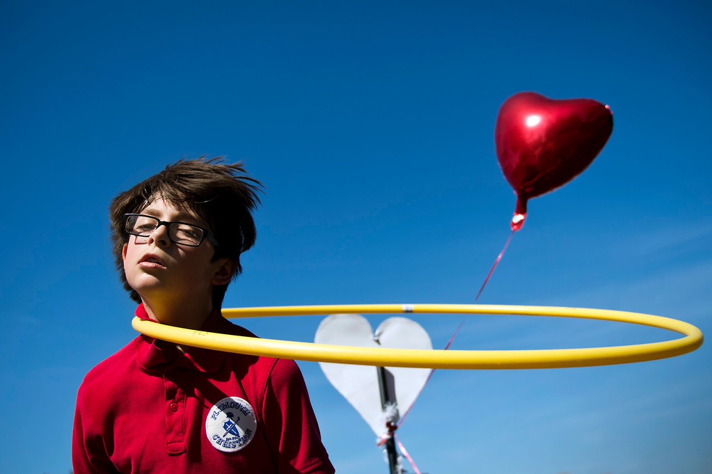 . Tristan Swav, 9, spins a Hula-Hoop on his neck during an exercise at Plymouth Christian School in Whittier on Friday, Feb. 14, 2014. The school held the exercise event to promote good health. (Photo by Watchara Phomicinda/ Whittier Daily News)