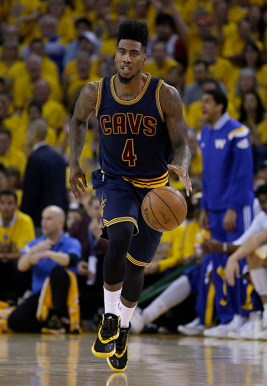 . Cleveland Cavaliers guard Iman Shumpert (4) dribbles against the Golden State Warriors during the first half of Game 1 of basketball\'s NBA Finals in Oakland, Calif., Thursday, June 4, 2015. (AP Photo/Ben Margot)