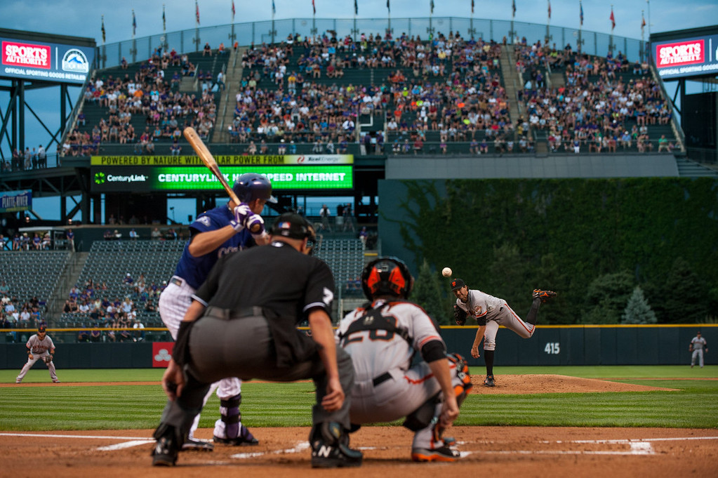 . Barry Zito #75 of the San Francisco Giants delivers a pitch to Michael Cuddyer #3 of the Colorado Rockies as Buster Posey #28 catches in the first inning of a game at Coors Field on August 26, 2013 in Denver, Colorado. (Photo by Dustin Bradford/Getty Images)