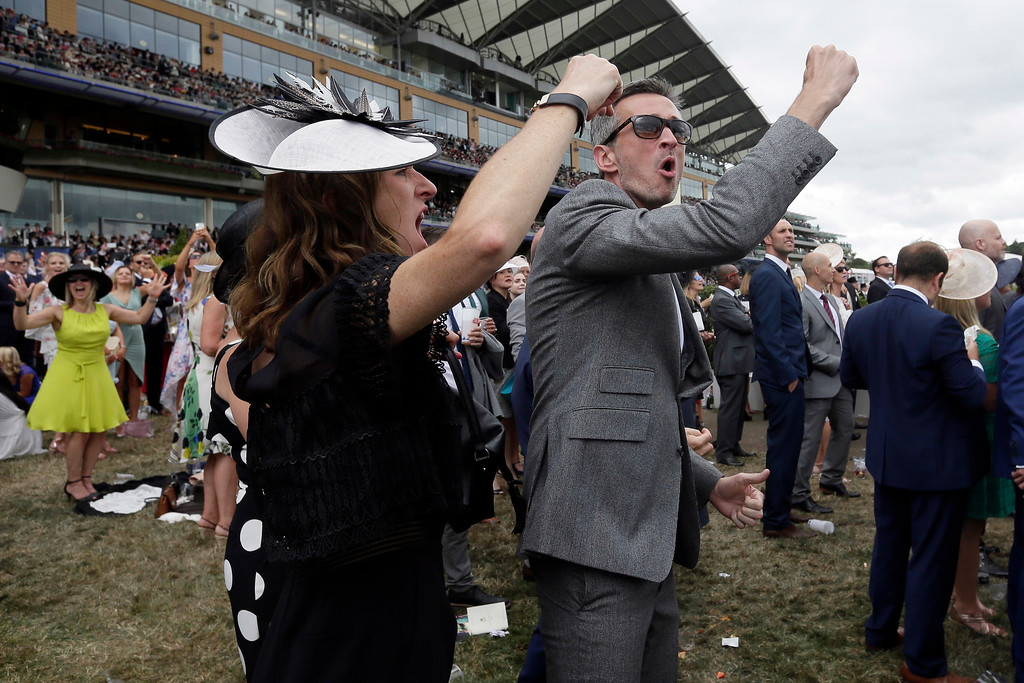 . Racegoers cheer on the second day of the Royal Ascot horse race meeting in Ascot, England, Wednesday, June 20, 2018. (AP Photo/Tim Ireland)