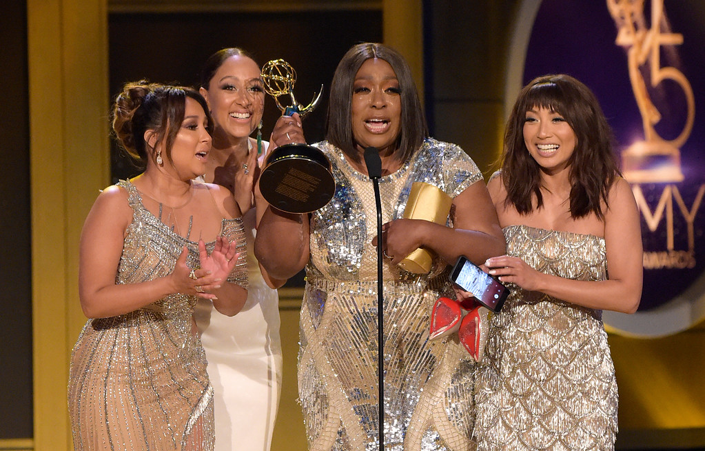 ". Adrienne Houghton, from left, Tamera Mowry-Housley, Loni Love and Jeannie Mai accept the award for outstanding entertainment talk show host for ""The Real\"" at the 45th annual Daytime Emmy Awards at the Pasadena Civic Center on Sunday, April 29, 2018, in Pasadena, Calif. (Photo by Richard Shotwell/Invision/AP)"