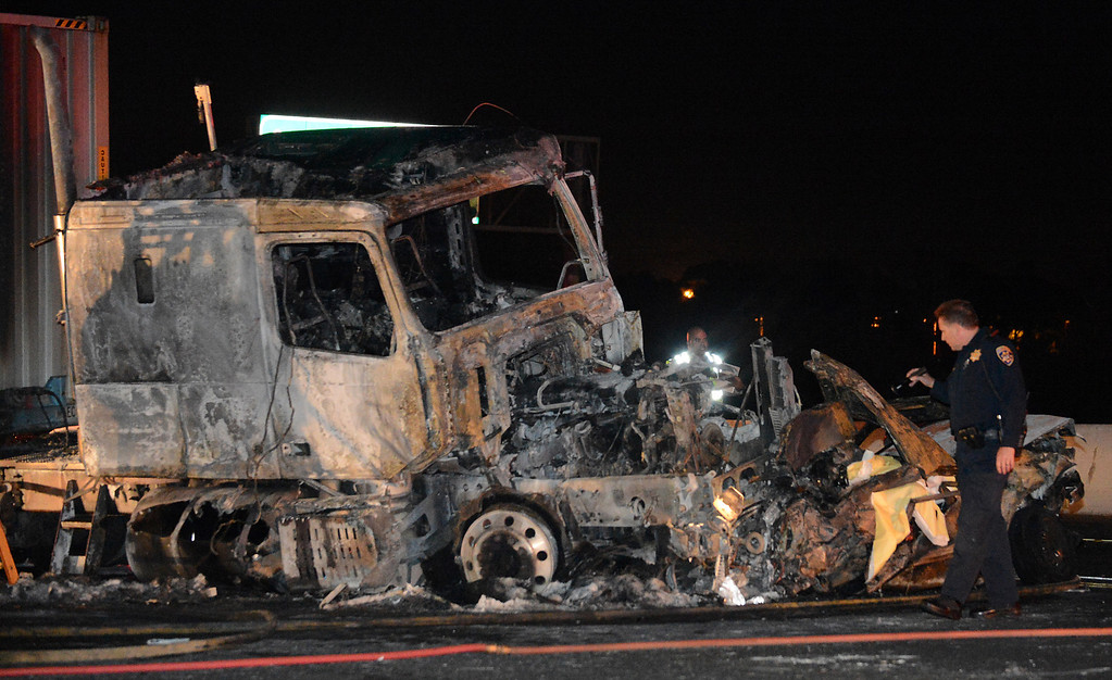 . CHP investigates the scene of a fatal traffic collision and fire involving a big rig Monday, August 19, 2013, on the eastbound lanes of the 10 freeway at Towne Ave in Pomona, CA. Jennifer Cappuccio Maher/Inland Valley Daily Bulletin