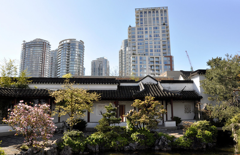 Old and new, same place, same time. This is in Vancouver British Columbia. View from the Dr. Sun Yat-Sen Garden on the modern skyline.  http://sillymonkeyphoto.com
