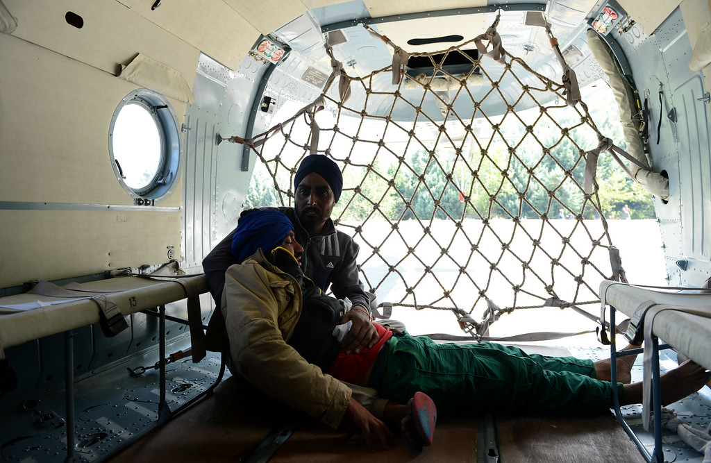 . An unwell patient evacuated from a flood-affected area lies inside an Indian Air Force helicopter during rescue and relief operations in Srinagar on September 10, 2014.  AFP PHOTO/Tauseef MUSTAFA/AFP/Getty Images
