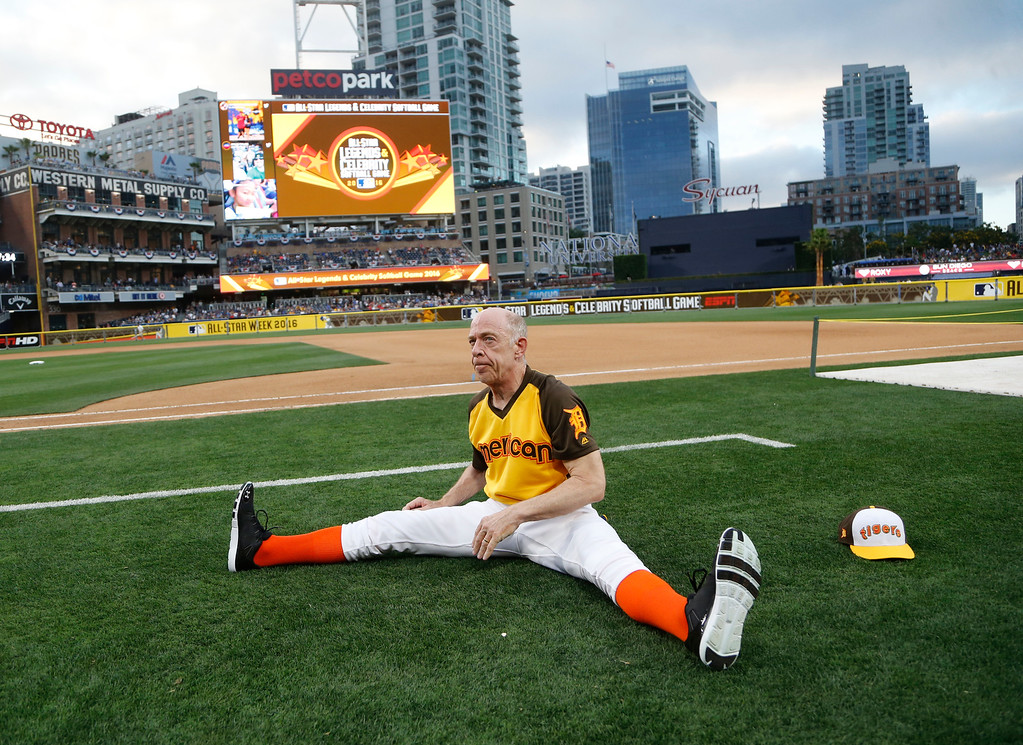 . Actor J.K. Simons stretches during the All-Star Legends & Celebrity Softball game, Sunday, July 10, 2016, in San Diego. (AP Photo/Lenny Ignelzi)