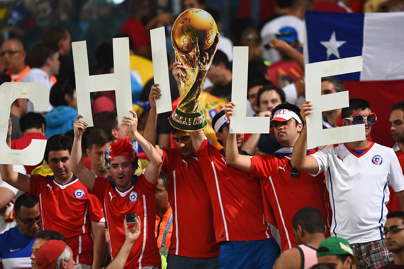 . Chile fans cheer during the 2014 FIFA World Cup Brazil Group B match between Spain and Chile at Maracana on June 18, 2014 in Rio de Janeiro, Brazil.  (Photo by David Ramos/Getty Images)