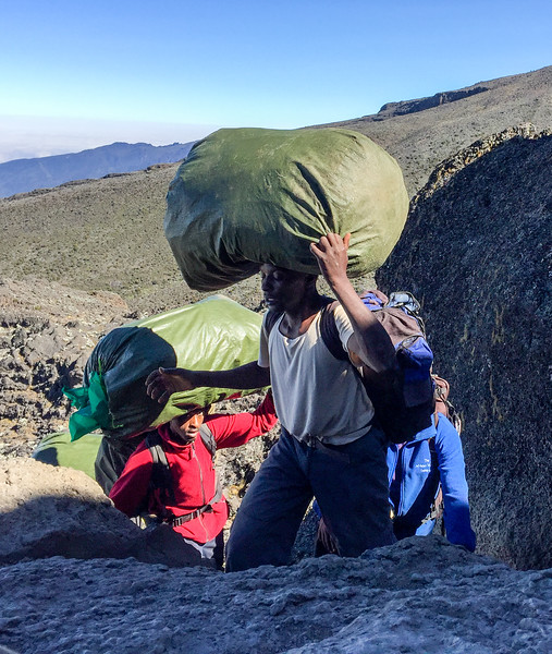 Going up the Barranco Wall which was hand over hand climbing.  The porters did it with ease with full loads on their heads.  Quite often they didn't need their hands to balance the baggage.