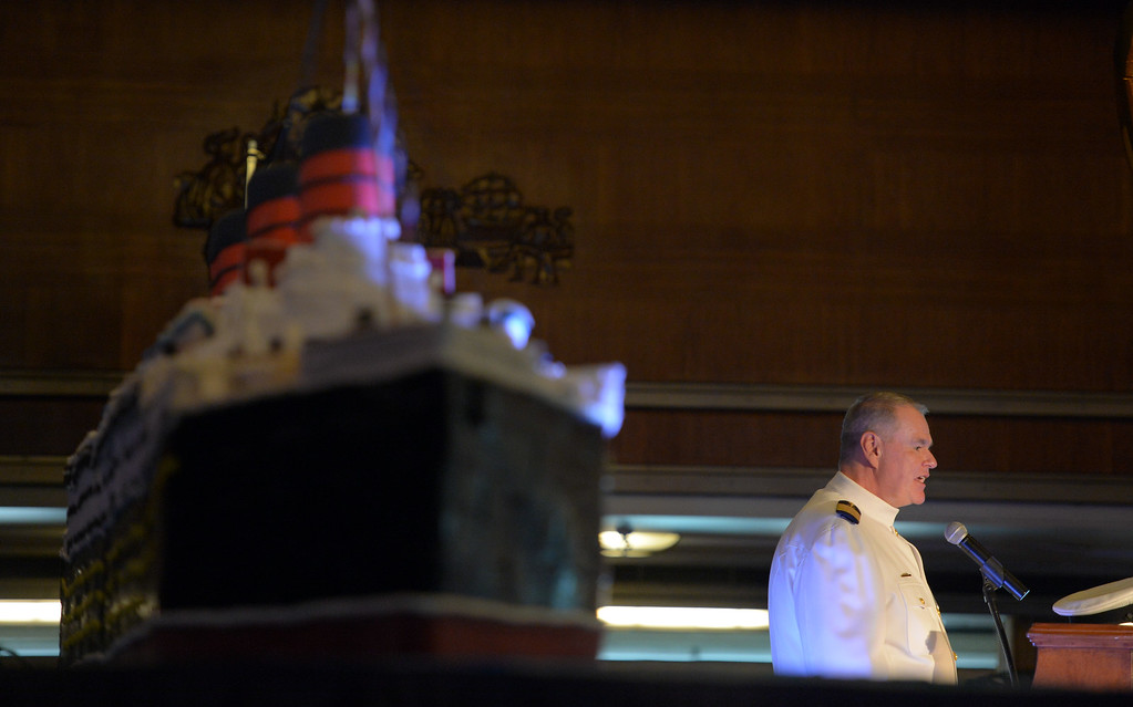 . In front of a giant replica Queen Mary cake, Commodore Everette Hoard tells the history of the ship as he celebrates the 80th anniversary of her launching in Long Beach, CA on Friday, September 26, 2014. After some speeches and a short film, guests were able to sample a slice of cake from a 15-foot long, 600-pound replica of the ship made by baker Jose Barajas. (Photo by Scott Varley, Daily Breeze)