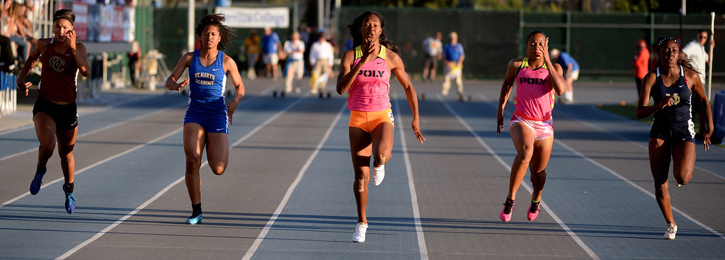 . Oaks Christian\'s Schuyler Moore, St. Mary\'s Academy\'s Sierra Peterson, Long Beach Poly\'s Arianna Washington, center, teammate Jade Lewis, Notre Dame\'s Dontella Asemota in the 100 meter dash during the CIF-SS Masters Track and Field meet at Falcon Field on the campus of Cerritos College in Norwalk, Calif., on Friday, May 30, 2014. Washington won the race.    (Keith Birmingham/Pasadena Star-News)