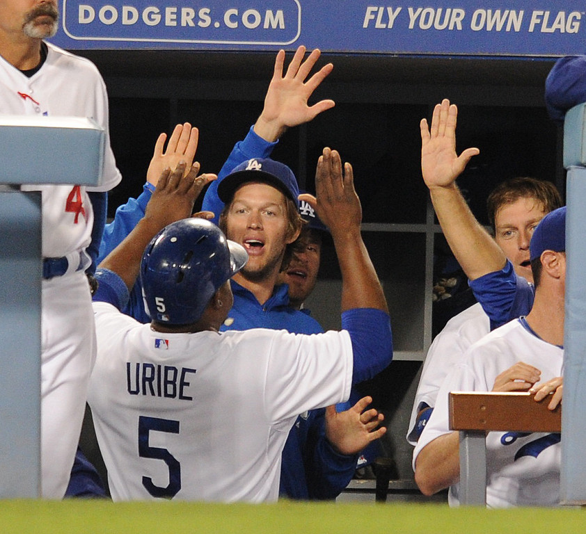 . Juan Uribe is welcomed into the dugout in the 2nd inning after he scored on a bunt by pitcher Edinson Volquez. The Dodgers played the Arizona Diamondbacks at Dodger Stadium in Los Angeles, CA. 9/10/2013. photo by (John McCoy/Los Angeles Daily News)