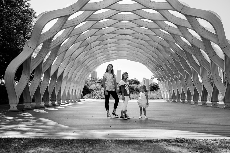 Sisters playing and having their outdoor, summer photo session at Lincoln Park Honeycomb, Chicago.