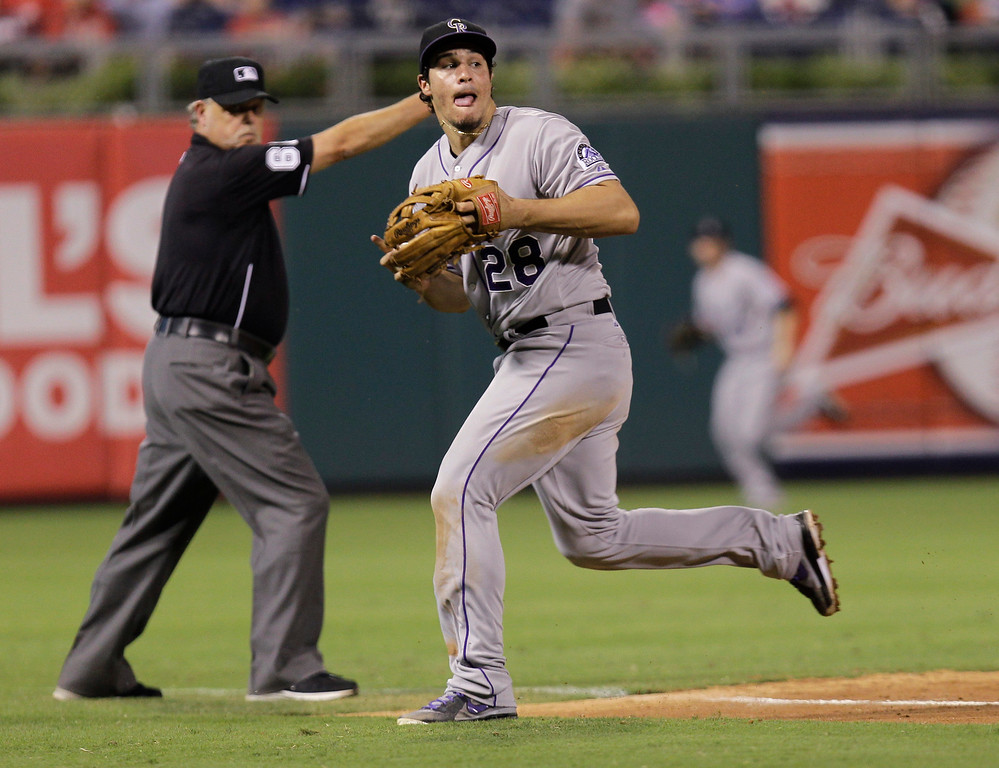 . Colorado Rockies\' Nolan Arenado prepares to throw to first in the seventh inning for the out on Philadelphia Phillies\' Jimmy Rollins in a baseball game, Tuesday, Aug. 20, 2013, in Philadelphia. (AP Photo/Laurence Kesterson)