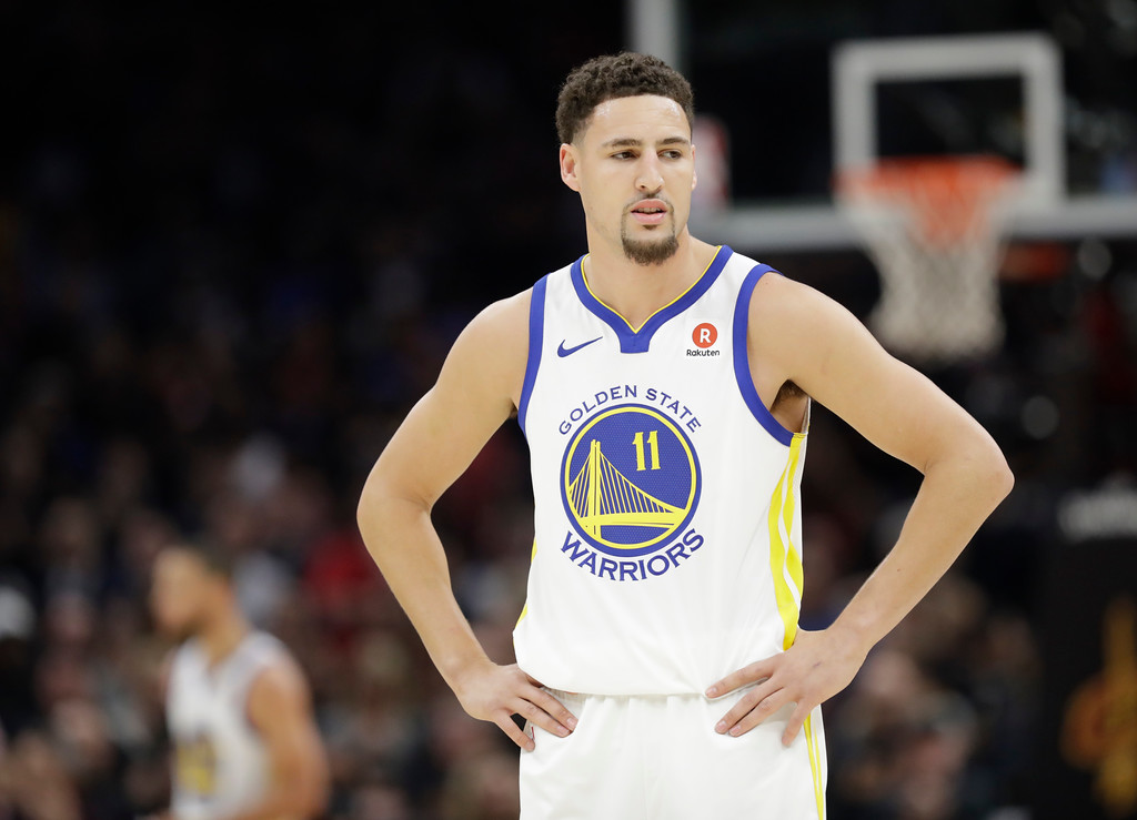 . Golden State Warriors\' Klay Thompson watches in the first half of Game 3 of basketball\'s NBA Finals against the Cleveland Cavaliers, Wednesday, June 6, 2018, in Cleveland. (AP Photo/Tony Dejak)
