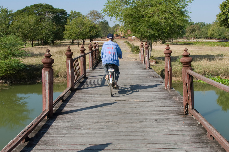 Man on Bike at the bridge in Sukhothai, Thailand
