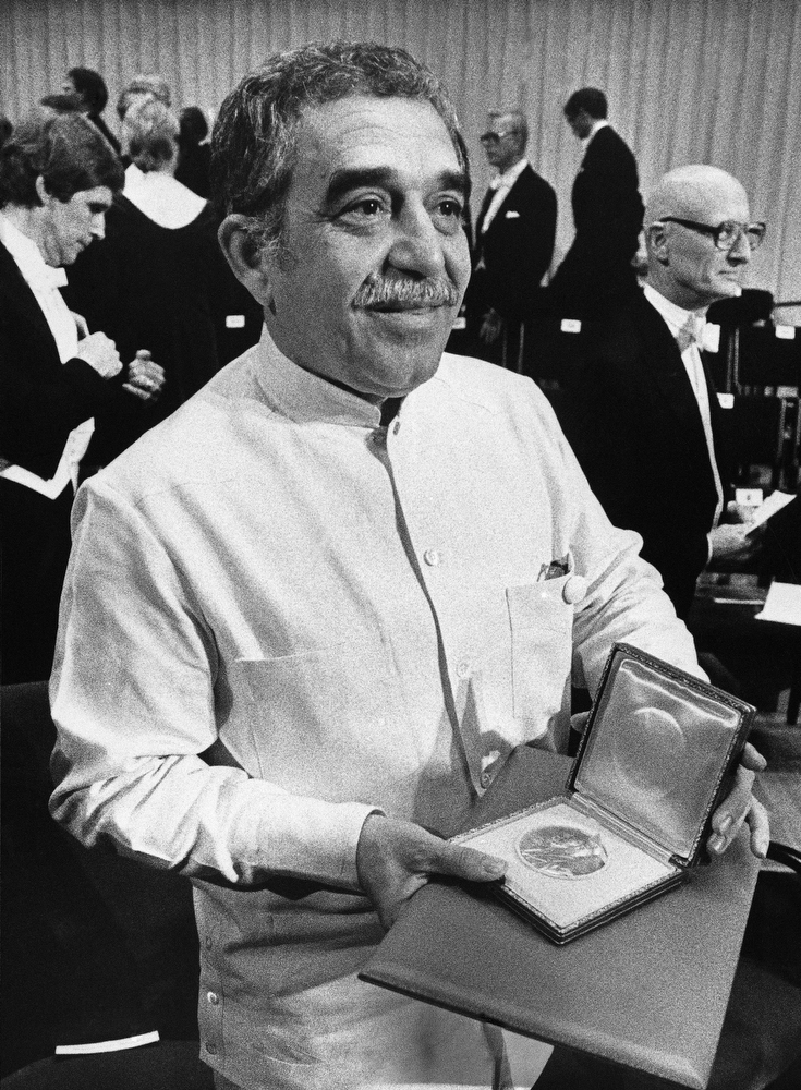 . In this Dec. 8, 1982 file photo, Nobel laureate Gabriel Garcia Marquez shows his Nobel Prize medal after he delivered his Nobel Lecture in Stockholm, Sweden. Marquez died Thursday April 17, 2014 at his home in Mexico City. (AP Photo/Bjorn Elgstrand, Pool, File)
