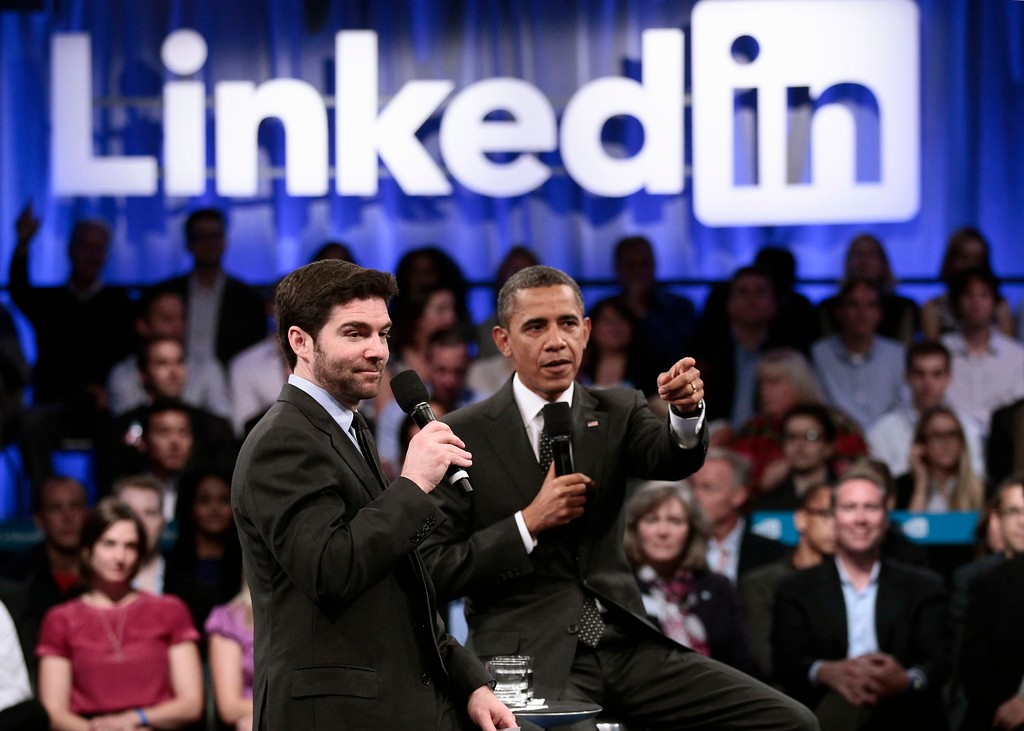 . President Obama, accompanied by LinkedIn CEO Jeff Weiner, gestures during a LinkedIn Town Hall Meeting at the Computer History Museum in Mountain View, Calif., Monday, Sept. 26, 2011, as he participates in �Putting America Back to Work: LinkedIn Presents a Town Hall with President Obama.�  (AP Photo/Pablo Martinez Monsivais)