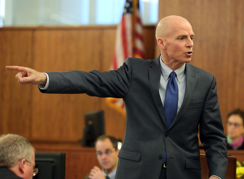 . Prosecutor William McCauley points to former New England Patriots football player Aaron Hernandez during his closing argument in Hernandez\'s trial in Fall River, Mass., Tuesday, April 7, 2015.  Hernandez is accused of killing Odin Lloyd in June 2013.  (AP Photo/The Boston Globe, John Tlumacki, Pool)