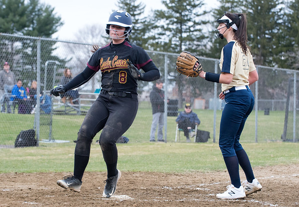 04/11/19 Wesley Bunnell | Staff New Britain softball defeated Newington on the road 4-1 on Thursday afternoon. Makaila Masterson (8) plates a New Britain run while Newington pitcher Danielle Pantano (21) covers home plate.