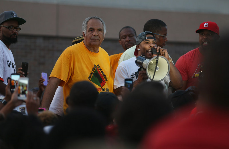 . Rapper Nelly uses a microphone to speak to demonstrators protesting the shooting death of Michael Brown on August 18, 2014 in Ferguson, Missouri. Protesters have been vocal asking for justice in the shooting death of Michael Brown by a Ferguson police officer on August 9th.  (Photo by Joe Raedle/Getty Images)