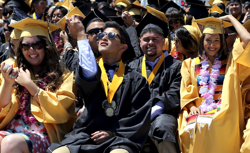 . Watsonville High graduates laugh, cheer, and unleash streams of Silly String during the 2013 graduation ceremony on Friday. (Kevin Johnson/Sentinel)