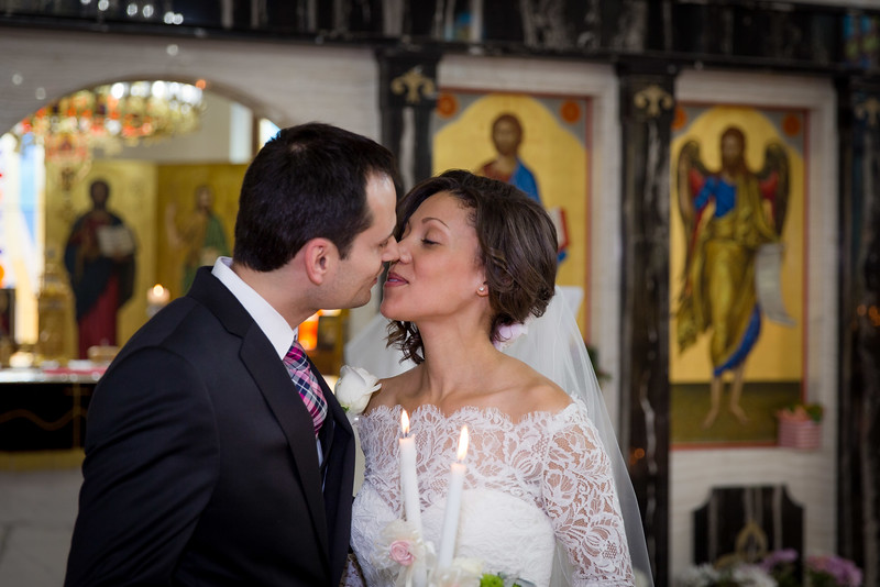 First kiss, photographed at Saint Sophia Bulgarian Orthodox Church in Chicago area (Des Plaines, IL)