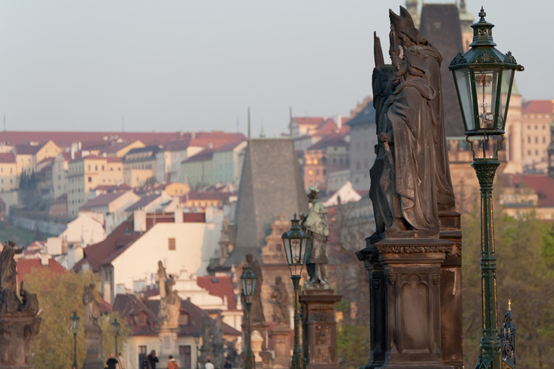 Statues and lamp posts in Charles Bridge - Prague, Czech Republic