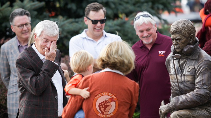 Frank Beamer wipes away tears after the statue is revealed to the public. (Mark Umansky/TheKeyPlay.com)